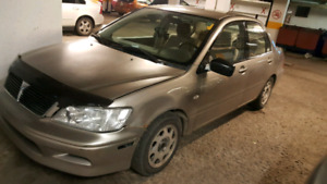Mitsubishi Lancer 2003 run and drive (for parts or to be fixed)