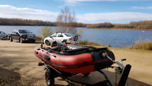 2016 inflatable boat, motor and trailer