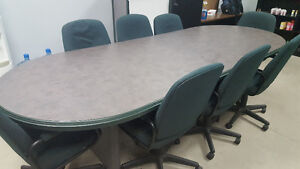Conference table with chairs at white board