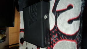 Xbox 360 with multiple games and accessories