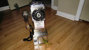 Old fashioned style pay phone with push button technology