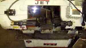 Jet hydraulic wet saw for cutting steel