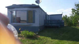 14 by 74 fully renovated mobile home for sale on leased 35 acres