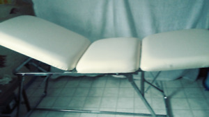 White leather massage table