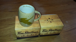 Two collectors Tim Hortons mugs
