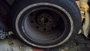 4 MotoMaster SE tires with rims