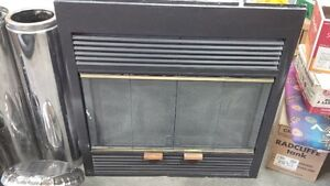 Barely used wood burning fireplace in excellent condition