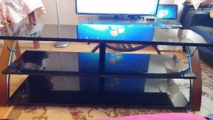 Très belle table TV  dessus en verre
