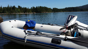 Kodiak Zoom 310s and 6hp Evinrude.