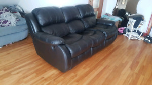 Leather reclining couch **Free Delivery**