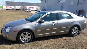 Ford Fusion Sel V6 AWD automatic with clear car proof