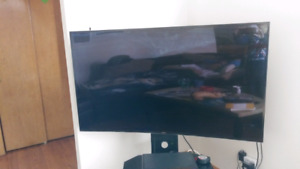 """55"""" 4k curved l.e.d. tv with stand 250$ o.b.o."""