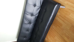 Black faux leather futon.6mths old.Bought at Walmart.Asking $120