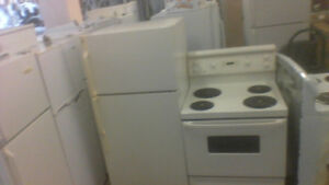 GE BISQUE FRIDGE AND 30'' MATCHING STOVE.