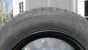 """Set of 4 - P185 65 15""""  Winter tires mounted on steel rims."""