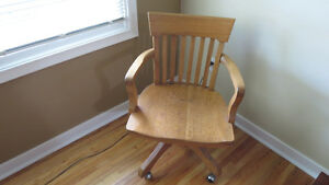 Beautifully refinished oak swivel arm chair