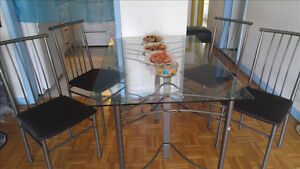 Glass dinner table with 4 chairs