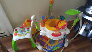 Excersaucer/jolly jumper, activity table, and floormat