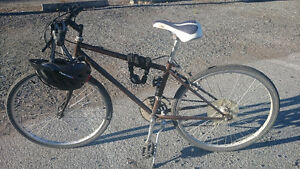 Mountain bike for sale, comes with helmet and lock
