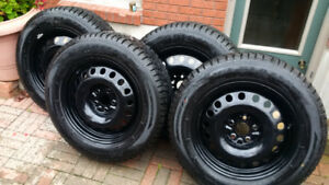 FOR SALE-WINTER TIRES ON STEEL RIMS. Nearly new, used 1\2 season