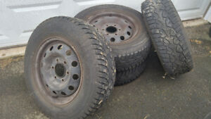 Used General Altimax Arctic winter tires and rims