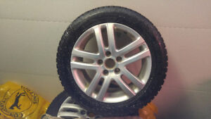 Vw oem rims with snows