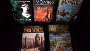 5 hardcover fantasy/adventure/vampire thriller books.