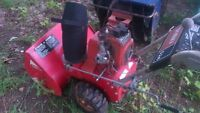 Two old snowblowers for parts or repair.