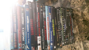 Stack of assorted DVDs and bluerays