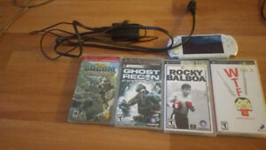 PSP W/ Charger and Games