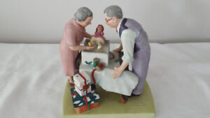 WRAPPING CHRISTMAS PRESENTS BY NORMAN ROCKWELL
