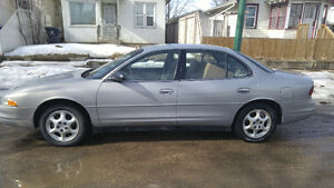 1999 Oldsmobile Intrigue Sedan with extra stuff!