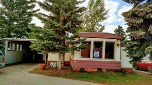 GREAT PRICE on this mobile home in Greenwood in Calgary!