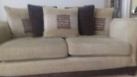 Beige sofa with scatter cushions