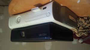 2 xbox 360 with steering wheel and 31 games.. Check description