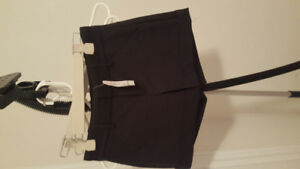 Brand New Bebe Cuffed Shorts One is Black and the Other is White