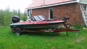 5 seater bass boat with ski pole & 150 merc 13000$ obo or trade