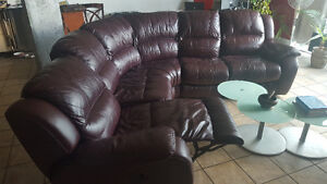 Large burgundy leather sectional with recliner seats