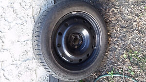 4  studded winter tires on 5x100 rims Moose Jaw Regina Area image 4