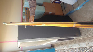 7 pool cues and a granny stick