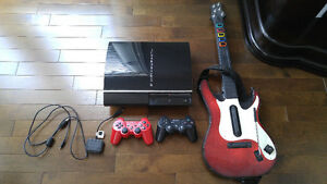 PS3 console + games + guitar