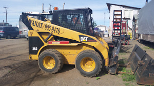 Tandem trucks and skid steer for hire call 7809059476