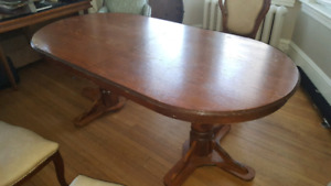 Solid wood table with expansion leaf