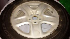 "Bridgestone ""Studless"" Winter tires with rims"