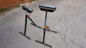 Two adjustable roller stands