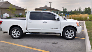 2009 nissan titan might trade for side by side