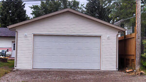 GARAGE BUILDERS.........LOWEST PRICE IN THE CITY