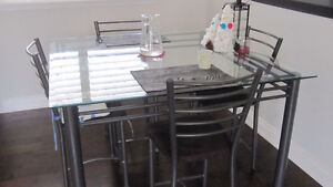 Large glass top pub (bar height) dining table w 8 chairs