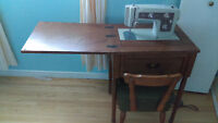 Kenmore sewing machine in foldaway wooden desk