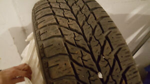 4 Winter tires Goodyear 215/70R15 mounted on rims slightly used